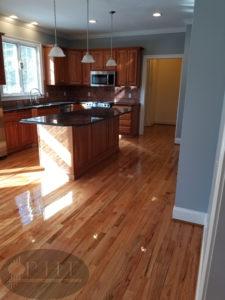 Red oak kitchen refinishing using three coats oil base finish.