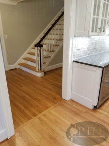 Refinished oak floors with one coat golden pecan stain and three coats oil base satin.